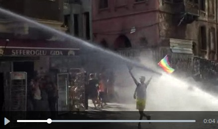 Screenshot of a video where an armed police vehicle, TOMA, hits an LGBTI activist during the 2015 Pride Parade directly and with full force using a pressurized water cannon. Consequences can be deadly.